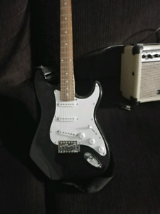 Electric guitar, amp, and tab books