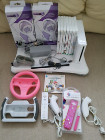 Wii + 8 games inc mario kart + wii fit board