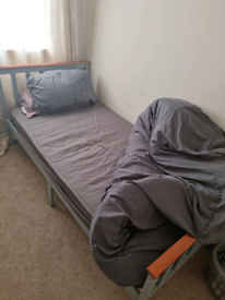 Single bed with matress and duvet bedding