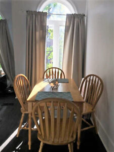 Solid oak farmhouse-style dining table and chairs