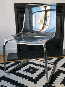 Two Ikea Tobias transparent chairs