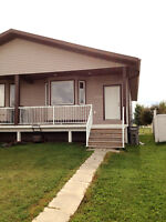 Large Mission Heights Duplex with full basement! Not a Suite!