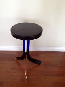 Hockey Puck Table with Recycled Stick Legs