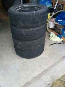 Snow tires with steel rims / $200.00 OBO Kawartha Lakes Peterborough Area image 1