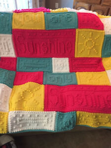 """Hand crocheted """"You are my sunshine"""" blanket."""