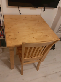 solid wood dining table and a chair