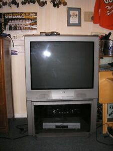 tv and hideabed couch