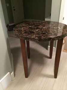 Round table with 2 leather chairs