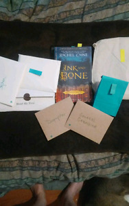 Ink & Bone book with related items 2 open along the way