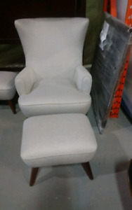 Light coloured Wingback accent chair with ottoman