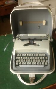 Vintage Portable Cavalier Typewriter with Key & Carrying Case