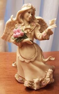 Sarah's Angels - Spring  $20  Fine hand painted figurine