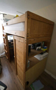 Bunk bed with desk underneath and accessories