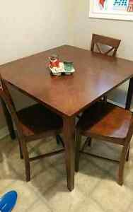 Pubstyle dining table and three chairs