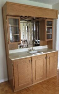 Wet Bar Oak With Sink Marble Counter Glass Cabinets Mirror Light