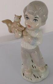 Porcelain figure. Jango, boy with squirrel. China ornament. Spanish. Spain.