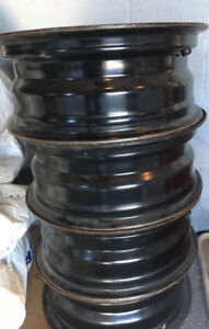 Used car rims and tires.