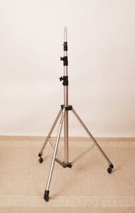 Manfrotto light stand on rollers.  Minimum height 45 inches to m