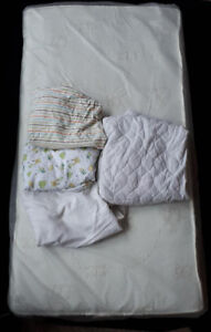 Crib Mattress, Waterproof Pad and Three Fitted Sheets