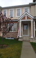 Airdrie Townhouse with Double Attached Garage for Rent