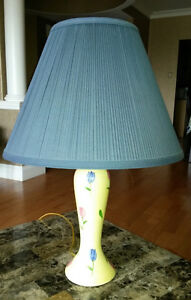 Yellow table lamp with blue shade