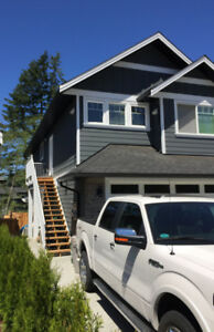 Furnished 1 Bd/1Bth above garage suite with laundry & dishwasher