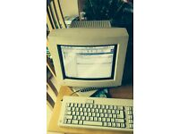 Apple Macintosh performa 6400/200 computer screen and keyboard Circa 1990s