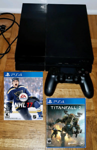 PS4 w 1TB hard drive and 2 games