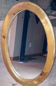 Antique wood oval mirror