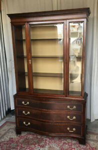 ** A large elegant antique display cabinet, newly refinished