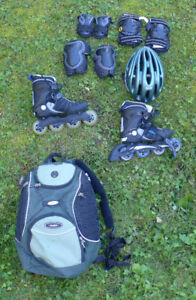 Like new woman's roller blades, safety gear & pack sack