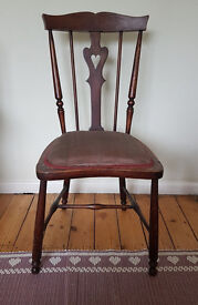 Vintage wooden chair with heart shaped cut out