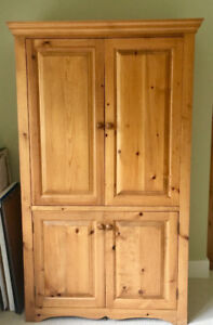 Solid pine tv/ storage armoire.
