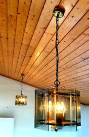 1970s brass and smoked glass pendant lights