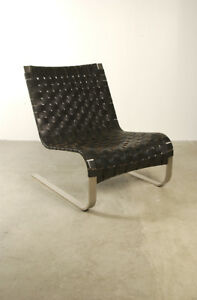 ONE OF A KIND SOLID STAINLESS STEEL & WOVEN LEATHER CHAIR