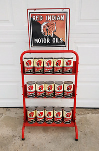 OIL RACK & 15 RED INDIAN OIL CANS FOR SALE