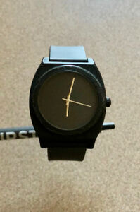 Nixon Men's Time Teller P Analog with Black Dial Watch