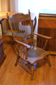 Antique oak chair with leather seat.
