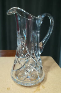 Vintage crystal pitcher, pinwheel and cross-cut design.