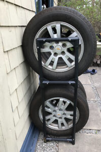 4 New Pirelli Tires with rims and tire rack