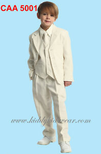 White communion suits and ring bearer tuxedos