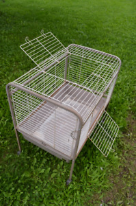 Brown metal cage for rabbits or guinea pigs