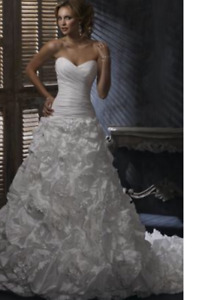 I am selling a Maggie Sottero Wedding Dress