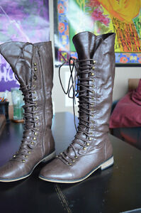 Brown knee high lace up faux leather riding boots, never worn