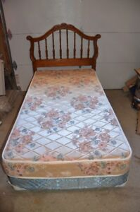 Twin bed including headboard, frame and mattress