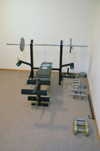 Weights and bench with curl and thigh attachments.