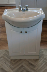 White vanity, ceramic sink, Moen faucet all in great condition.