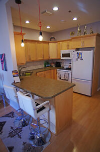 1 bed + den + underground parking and LOW condo fees!
