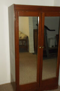 Wooden armoire with mirrored doors