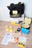 tire-lait medela pump in style double COMME NEUF